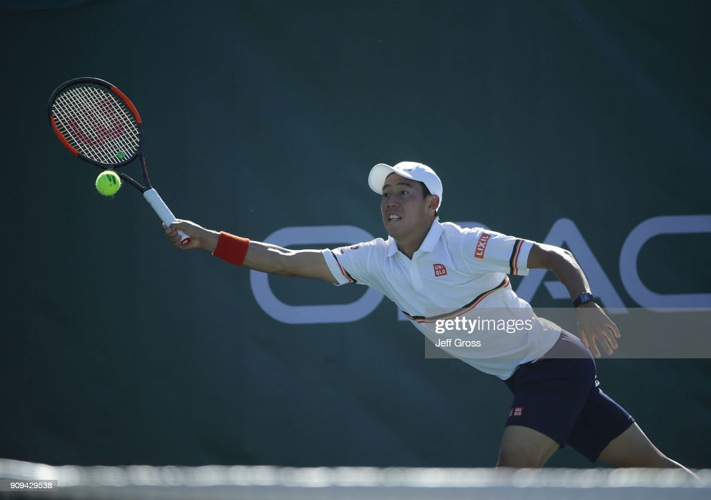 Kei Nishikori of Japan lunges to return a forehand to Dennis Novikov during the first round of the Oracle Challenger Series at the Newport Beach Tennis Club on January 23, 2018 in Newport Beach, California.