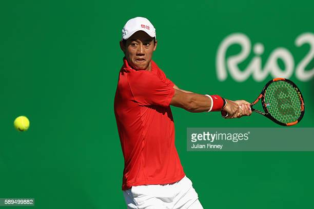 Kei Nishikori of Japan makes a backhand return during the singles bronze medal match against Rafael Nadal of Spain on Day 9 of the Rio 2016 Olympic...