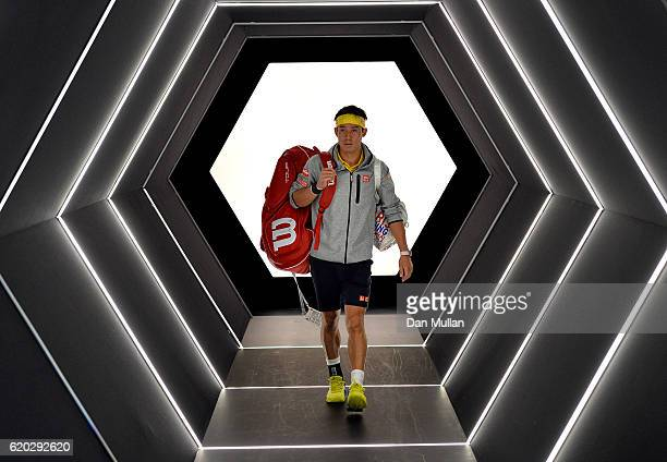 Kei Nishikori of Japan makes his way on court for his Mens Singles second round match against Viktor Troicki of Serbia on day three of the BNP...