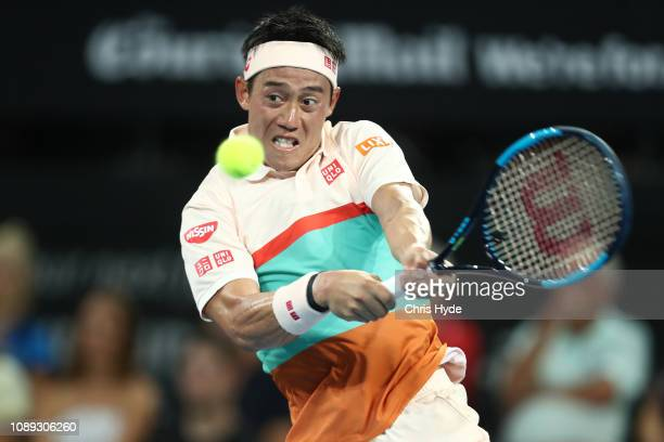 Kei Nishikori of Japan playa a backhand his match against Grigor Dimitrov during day five of the 2019 Brisbane International at Pat Rafter Arena on...