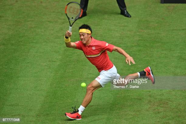 Kei Nishikori of Japan playes a forehand during his match against Matthias Bachinger of Germany during day 1 of the Gerry Weber Open at Gerry Weber...