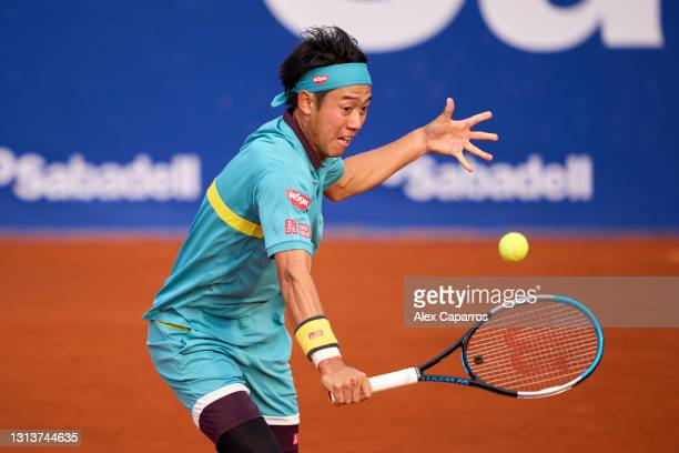 Kei Nishikori of Japan plays a backhand against Cristian Garin of Chile in their second round match during day three of the Barcelona Open Banc...