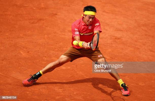 Kei Nishikori of Japan plays a backhand against Maxime Janvier of France in their first round mens singles match on day one of the French Open at...