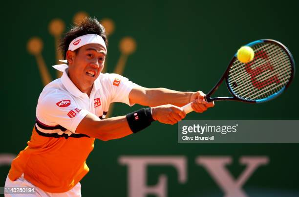 Kei Nishikori of Japan plays a backhand against PierreHugues Herbert of France in their second round match during day four of the Rolex MonteCarlo...