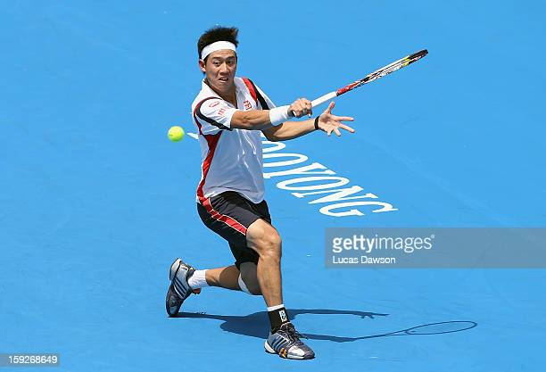 Kei Nishikori of Japan plays a backhand during his match against Paul-Henri Mathieu of France during day three of the AAMI Classic at Kooyong on...