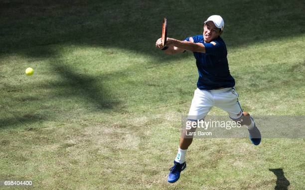 Kei Nishikori of Japan plays a backhand during his match against Fernando Verdasco of Spain during Day 4 of the Gerry Weber Open 2017 at on June 20...
