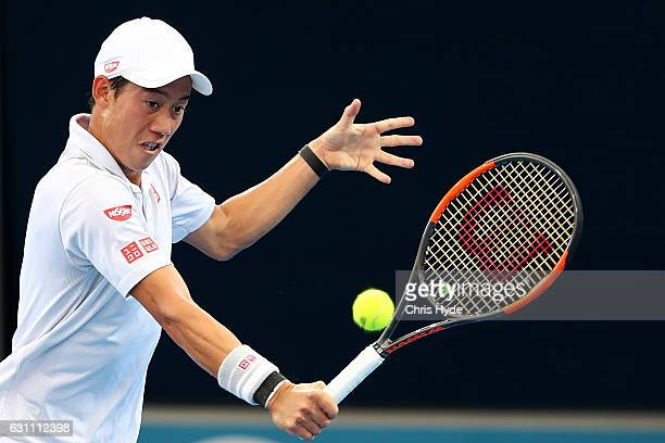 Kei Nishikori of Japan plays a backhand during his semi final match against Stan Wawrinka of Switzerland during day seven of the 2017 Brisbane...