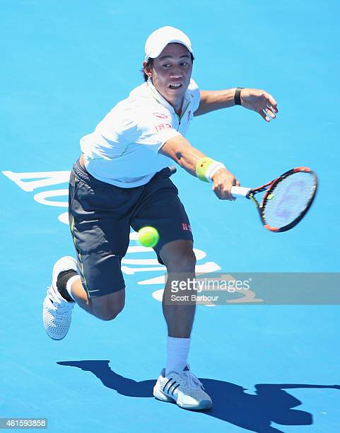Kei Nishikori of Japan plays a backhand during his third fourth place playoff match against Richard Gasquet of France during day four of the...