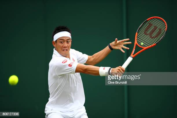 Kei Nishikori of Japan plays a backhand during the Gentlemen's Singles first round match against Marco Cecchinato of Italy on day one of the...