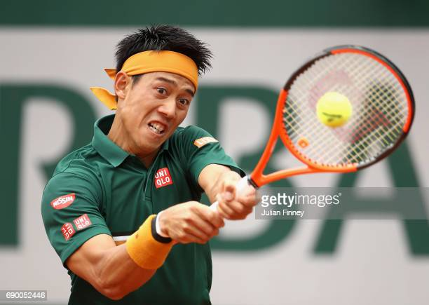 Kei Nishikori of Japan plays a backhand during the mens singles first round match against Thanasi Kokkinakis of Australia on day three of the 2017...