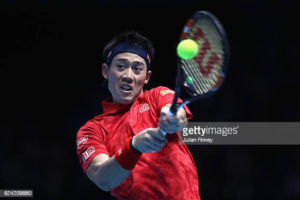 Kei Nishikori of Japan plays a backhand during the men's singles match against Marin Cilic of Croatia on day six of the ATP World Tour Finals at O2...