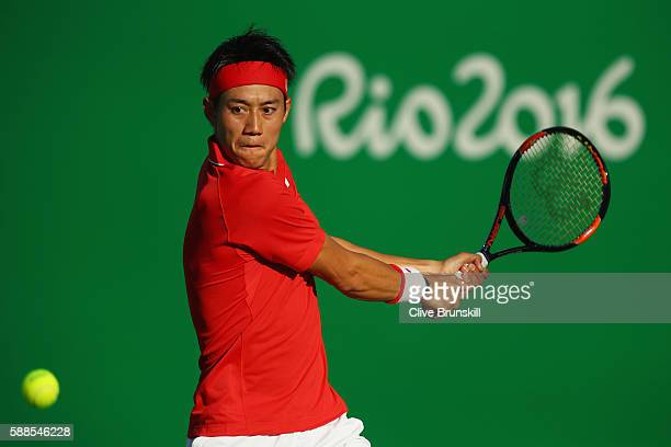 Kei Nishikori of Japan plays a backhand during the men's singles third round match against Andrej Martin of Slovakia on Day 6 of the 2016 Rio...