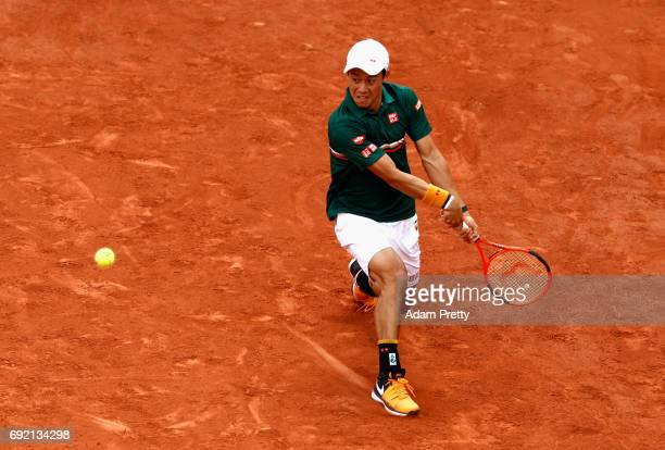 Kei Nishikori of Japan plays a backhand during the mens singles third round match against Hyeon Chung of Korea on day eight of the 2017 French Open...