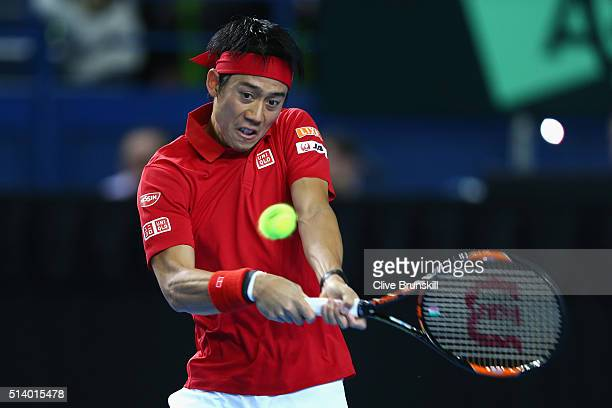 Kei Nishikori of Japan plays a backhand during the singles match against Andy Murray of Great Britain on day three of the Davis Cup World Group first...
