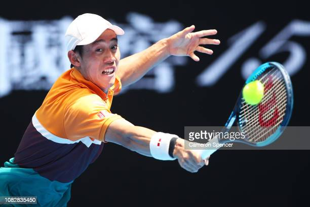 Kei Nishikori of Japan plays a backhand in his first round match aginst Kamil Majchrzak of Poland during day two of the 2019 Australian Open at...