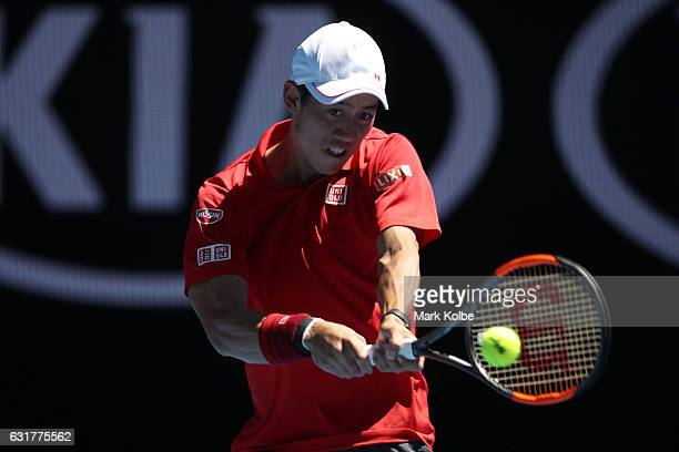 Kei Nishikori of Japan plays a backhand in his first round match against Andrey Kuznetsov of Russia on day one of the 2017 Australian Open at...