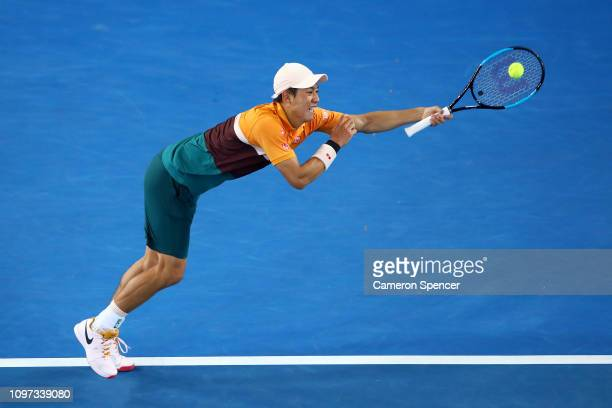 Kei Nishikori of Japan plays a backhand in his fourth round match against Pablo Carreno Busta of Spain during day eight of the 2019 Australian Open...