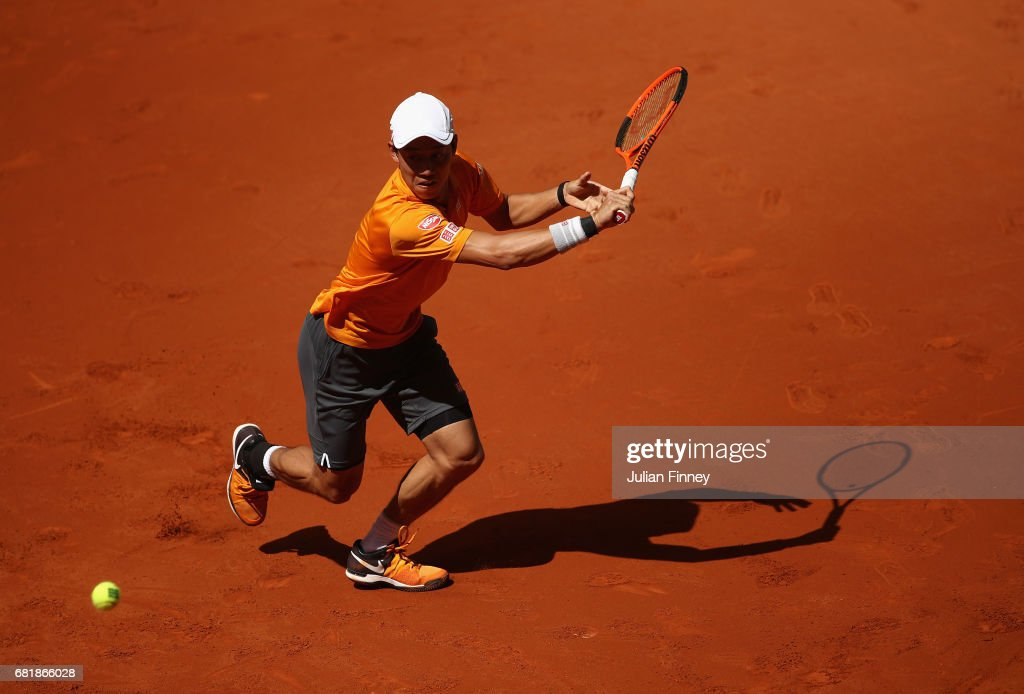 Kei Nishikori of Japan plays a backhand in his match against David Ferrer of Spain during day six of the Mutua Madrid Open tennis at La Caja Magica on May 11, 2017 in Madrid, Spain.