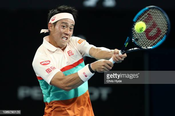 Kei Nishikori of Japan plays a backhand in his match against Grigor Dimitrov of Bulgaria during day five of the 2019 Brisbane International at Pat...
