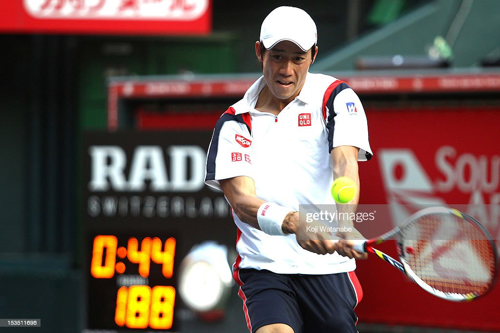 Kei Nishikori of Japan plays a backhand in his match against Marcos Baghdatis of Cyprus during day six of the Rakuten Open at Ariake Colosseum on October 6, 2012 in Tokyo, Japan.