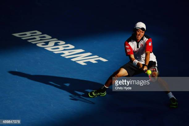 Kei Nishikori of Japan plays a backhand in his match against Matthew Ebden of Australia during day four of the 2014 Brisbane International at...