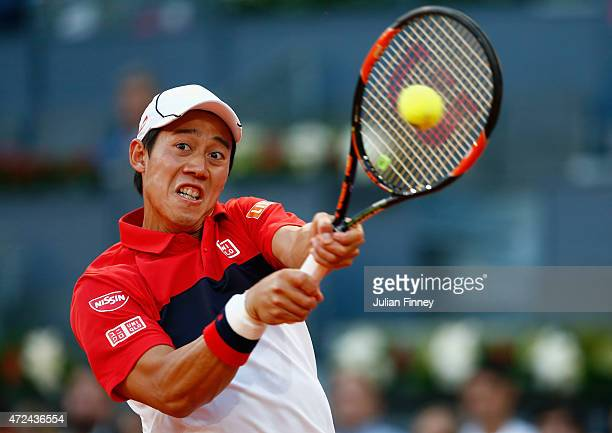 Kei Nishikori of Japan plays a backhand in his match against Roberto Bautista Agut of Spain during day six of the Mutua Madrid Open tennis tournament...