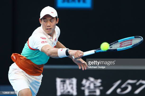 Kei Nishikori of Japan plays a backhand in his quarter final match against Novak Djokovic of Serbia during day 10 of the 2019 Australian Open at...