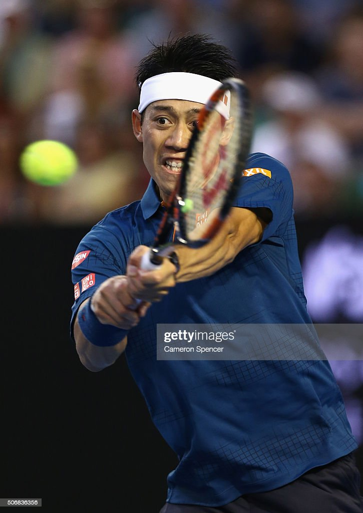 Kei Nishikori of Japan plays a backhand in his quarter final match against Novak Djokovic of Serbia during day nine of the 2016 Australian Open at Melbourne Park on January 26, 2016 in Melbourne, Australia.