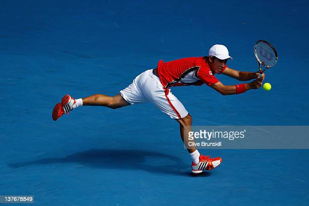 Kei Nishikori of Japan plays a backhand in his quarterfinal match against Andy Murray of Great Britain during day ten of the 2012 Australian Open at...