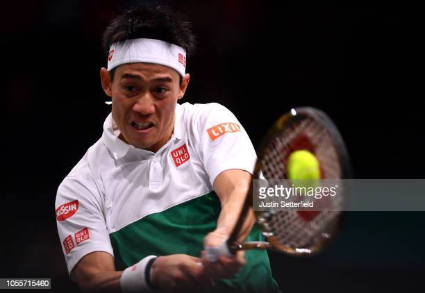 Kei Nishikori of Japan plays a backhand in his second round match against Adrian Mandarin of France during Day 3 of the Rolex Paris Masters on...