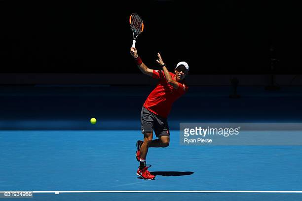 Kei Nishikori of Japan plays a backhand in his second round match against Jeremy Chardy of France on day three of the 2017 Australian Open at...