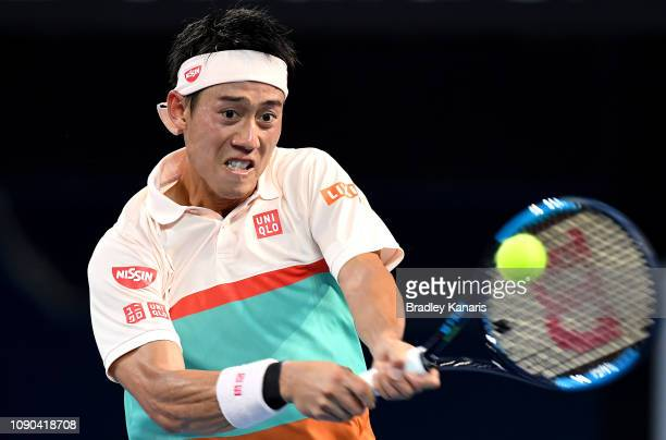 Kei Nishikori of Japan plays a backhand in the Men's Finals match against Daniil Medvedev of Russia during day eight of the 2019 Brisbane...