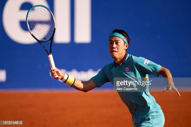 Kei Nishikori of Japan plays a forehand against Cristian Garin of Chile in their second round match during day three of the Barcelona Open Banc...