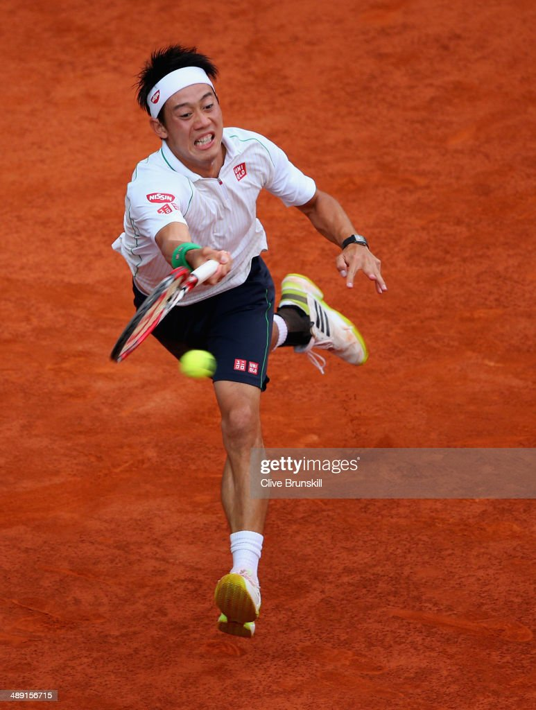 Kei Nishikori of Japan plays a forehand against David Ferrer of Spain in their semi final match during day eight of the Mutua Madrid Open tennis tournament at the Caja Magica on May 10, 2014 in Madrid, Spain.