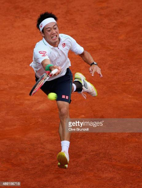 Kei Nishikori of Japan plays a forehand against David Ferrer of Spain in their semi final match during day eight of the Mutua Madrid Open tennis...
