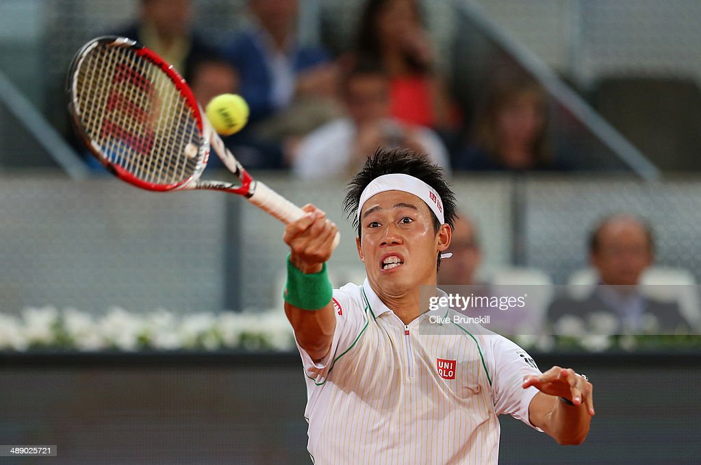 Kei Nishikori of Japan plays a forehand against Feliciano Lopez of Spain in their quarter final match during day seven of the Mutua Madrid Open tennis tournament at the Caja Magica on May 9, 2014 in Madrid, Spain.