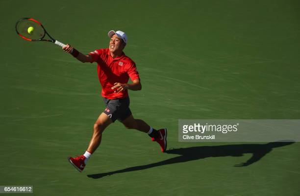 Kei Nishikori of Japan plays a forehand against Jack Sock of the United States in in their quarter final match during day twelve of the BNP Paribas...