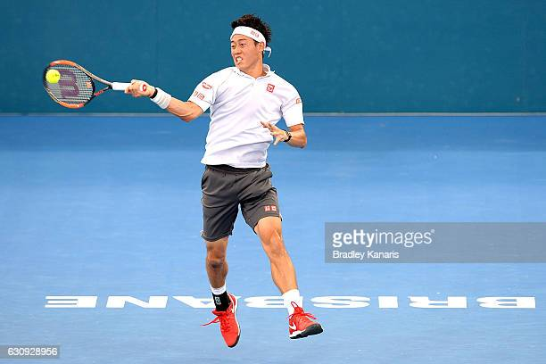 Kei Nishikori of Japan plays a forehand against Jared Donaldson of the USA on day four of the 2017 Brisbane International at Pat Rafter Arena on...
