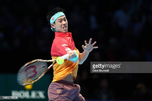 Kei Nishikori of Japan plays a forehand during his match against Roger Federer of Switzerland during Day One of the Nitto ATP Finals at The O2 Arena...