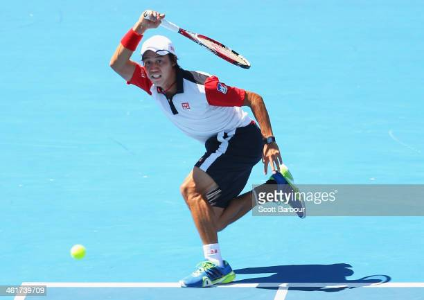 Kei Nishikori of Japan plays a forehand during his match against Tomas Berdych of the Czech Republic during day four of the AAMI Classic at Kooyong...