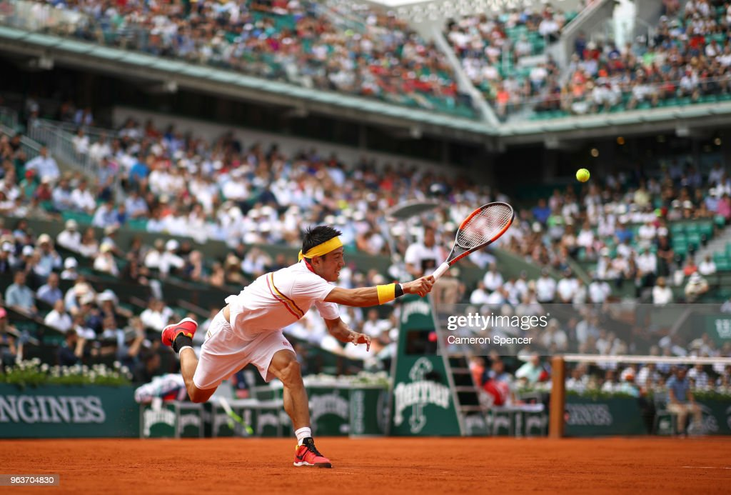 Kei Nishikori of Japan plays a forehand during his mens singles second round match against Benoit Paire of France during day four of the 2018 French Open at Roland Garros on May 30, 2018 in Paris, France.