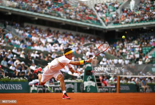 Kei Nishikori of Japan plays a forehand during his mens singles second round match against Benoit Paire of France during day four of the 2018 French...