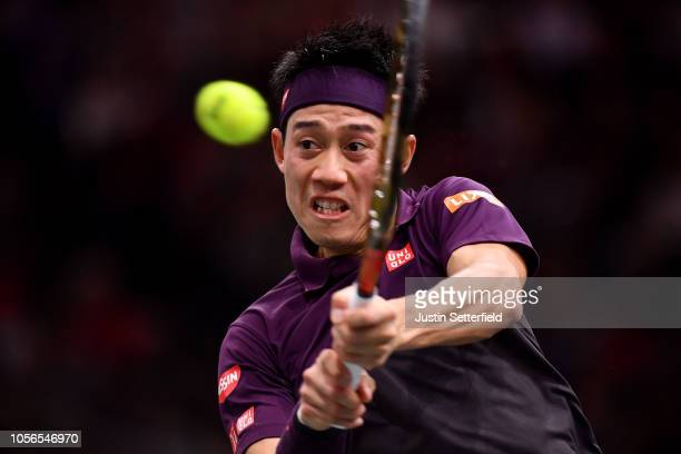 Kei Nishikori of Japan plays a forehand during his Quarter Final match against Roger Federer of Switzerland on Day 5 of the Rolex Paris Masters on...