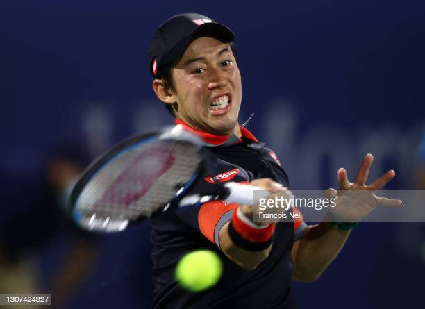 Kei Nishikori of Japan plays a forehand during his singles match against David Goffin of Belgium during Day Ten of the Dubai Duty Free Tennis at...
