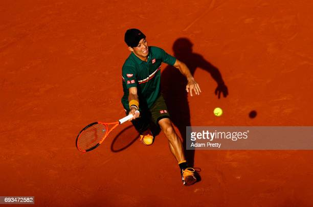 Kei Nishikori of Japan plays a forehand during mens singles quarter finals match against Andy Murray of Great Britain on day eleven of the 2017...
