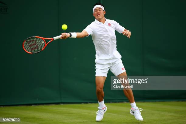 Kei Nishikori of Japan plays a forehand during the Gentlemen's Singles first round match against Marco Cecchinato of Italy on day one of the...