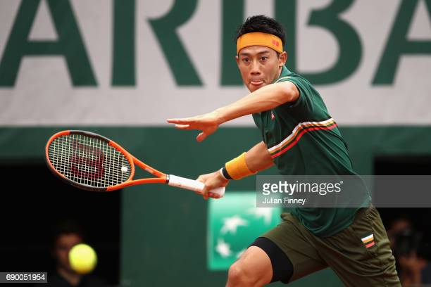 Kei Nishikori of Japan plays a forehand during the mens singles first round match against Thanasi Kokkinakis of Australia on day three of the 2017...