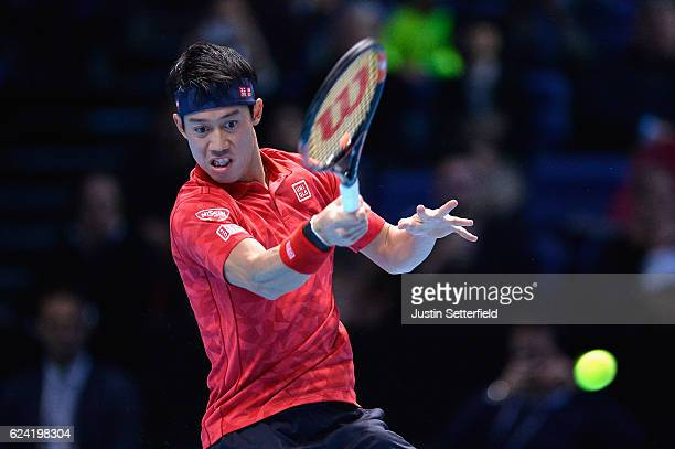 Kei Nishikori of Japan plays a forehand during the men's singles match against Marin Cilic of Croatia on day six of the ATP World Tour Finals at O2...