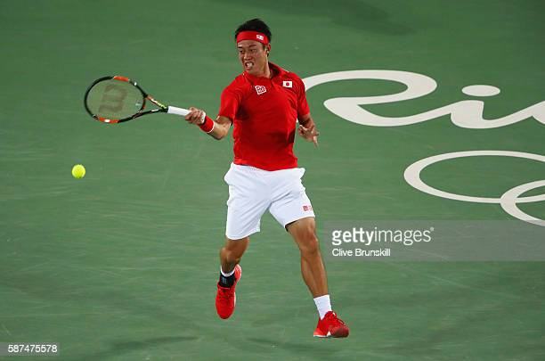 Kei Nishikori of Japan plays a forehand during the Men's Singles second round match against John Millman of Australia on Day 3 of the Rio 2016...