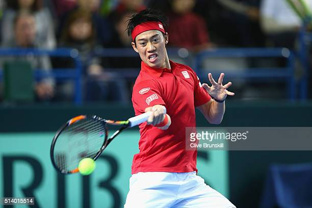 Kei Nishikori of Japan plays a forehand during the singles match against Andy Murray of Great Britain on day three of the Davis Cup World Group first...